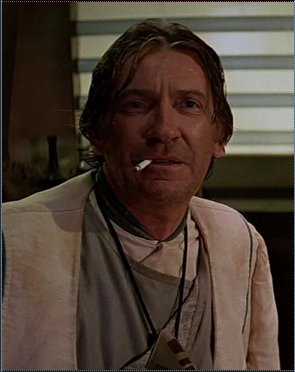 Screencap of David Warner in Star Trek V: The Final Frontier. A cigarette dangles from his mouth.